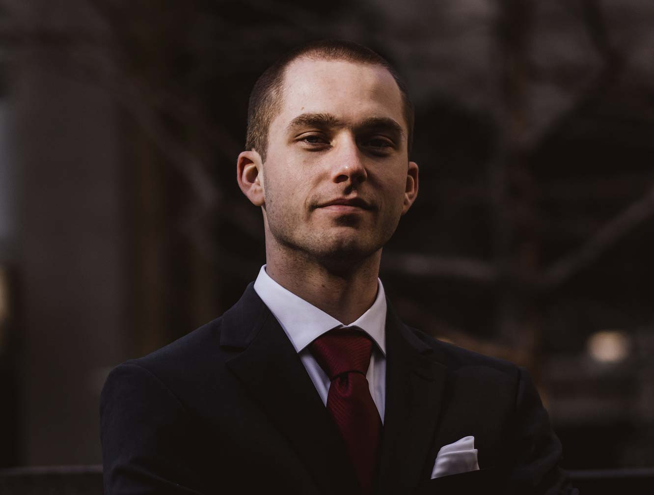 man with shaved head and suit