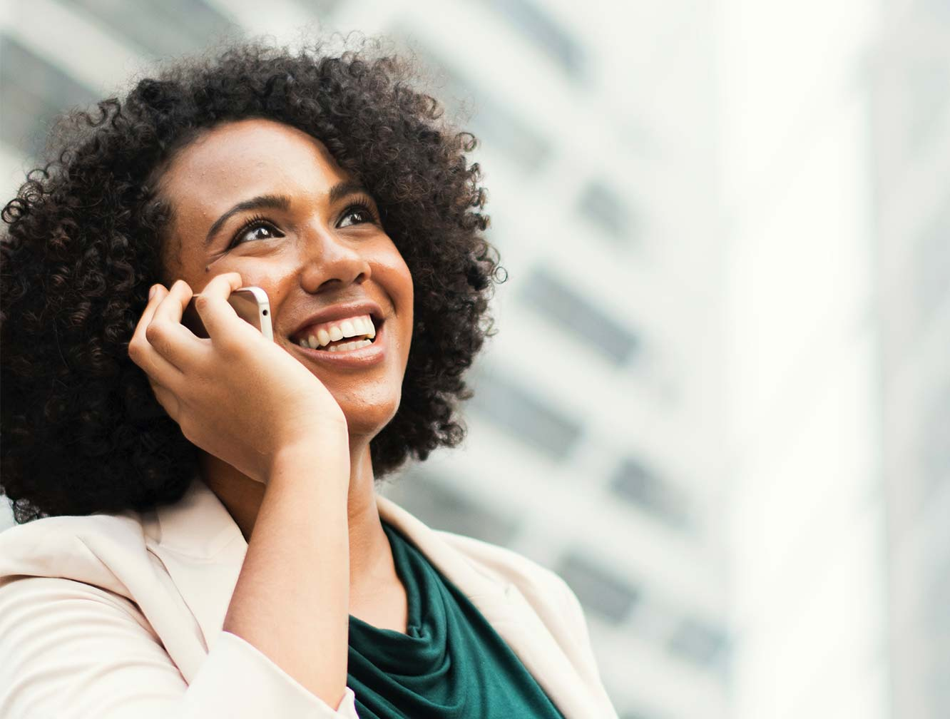 young lady with brown hair on the phone